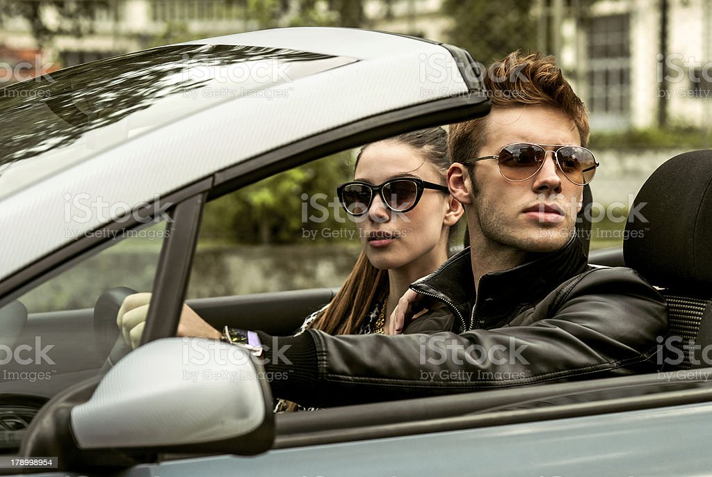 good looking couple inside a cabriolet car royalty-free stock photo