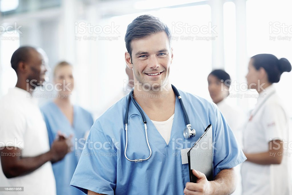 Good looking male nurse with medical team stock photo
