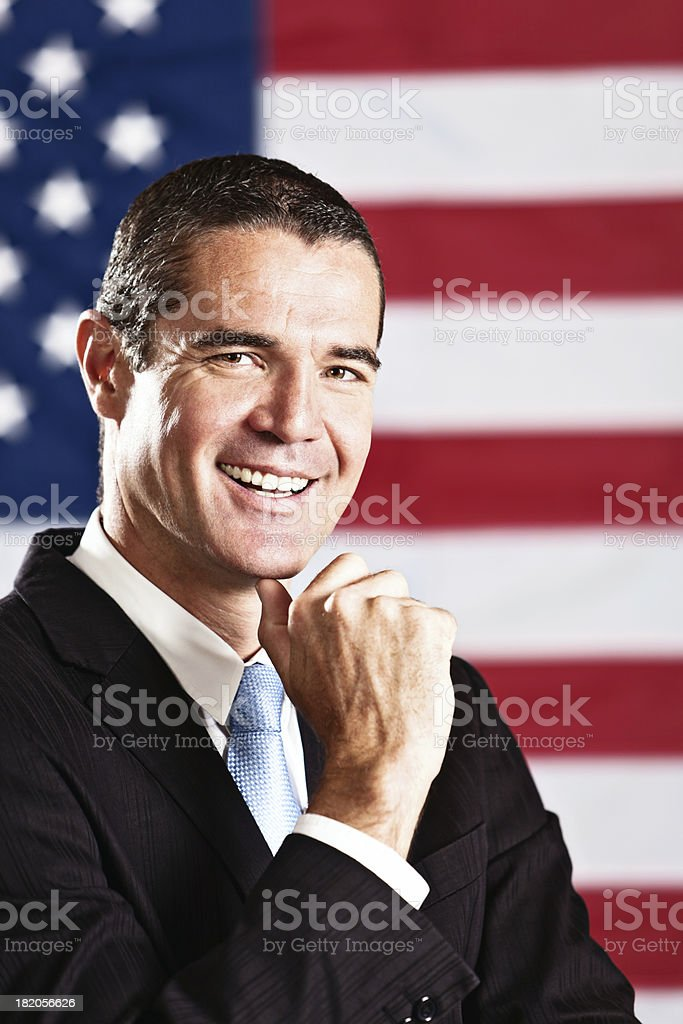 Good looking politician or VIP smiles with Stars and Stripes stock photo