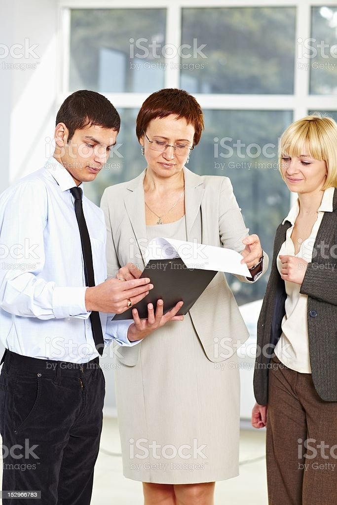Good looking teacher with students royalty-free stock photo