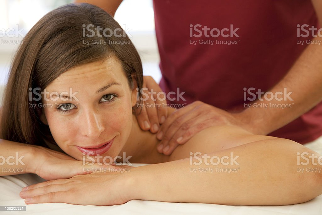 Good looking woman receives a massage royalty-free stock photo