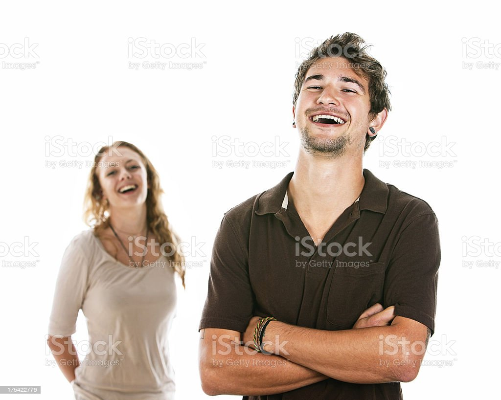 Good looking young couple laughing together stock photo