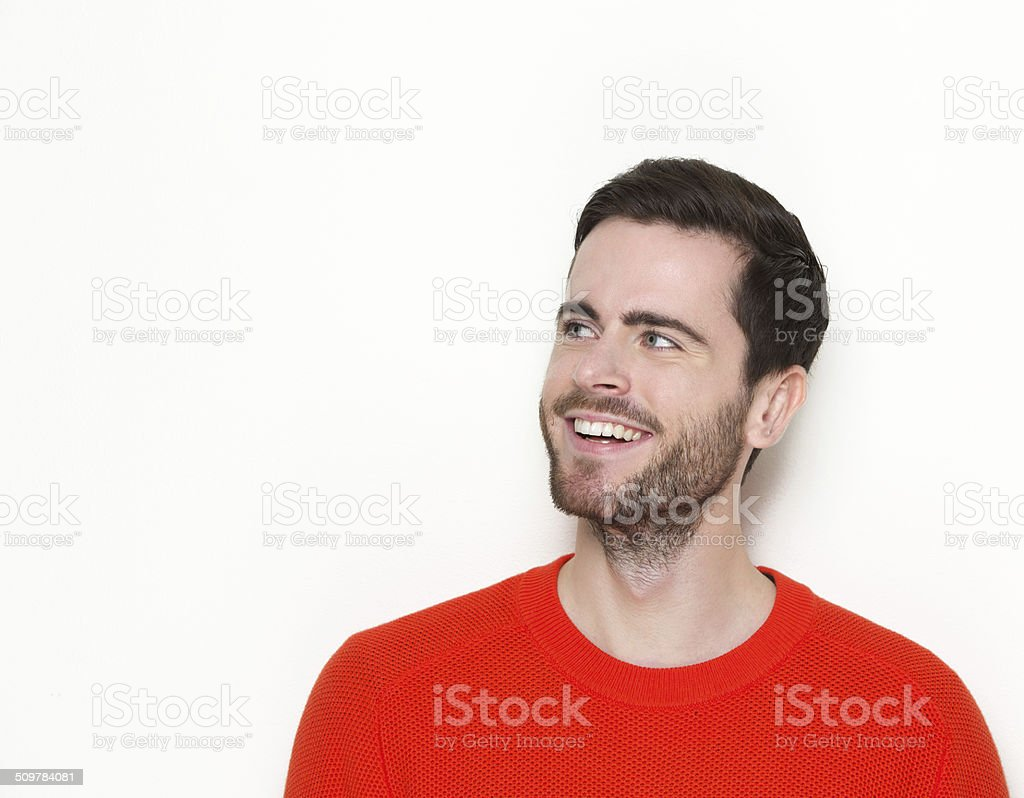 Good looking young man smiling stock photo