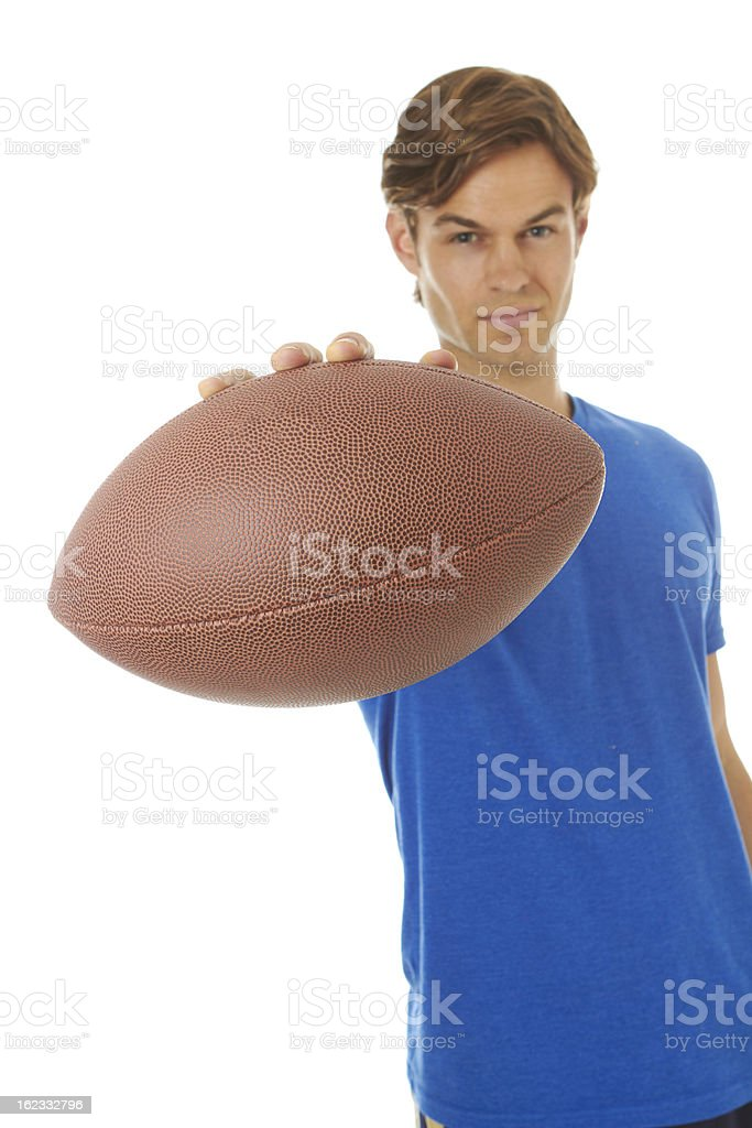 Good looking young white male holding football stock photo
