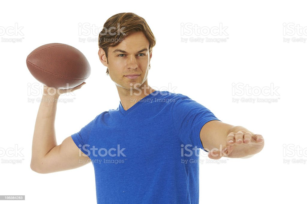 Good looking young white male throwing football stock photo