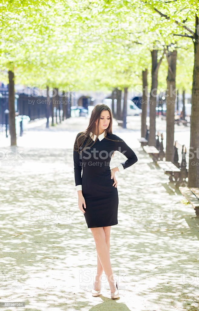 Good Looking Young Woman In A Sunny City Park stock photo