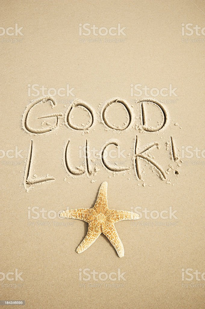 Good Luck Message Handwritten in Sand with Starfish royalty-free stock photo