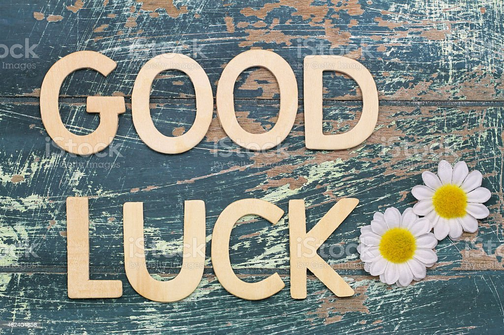 Good luck written with wooden letters on rustic wooden surface stock photo
