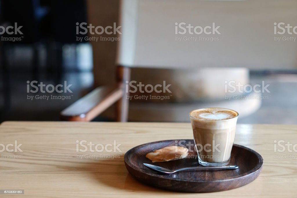 Good morning coffee cup - a cup of hot piccolo with latte art. stock photo