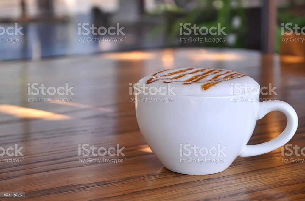 Good morning  with coffee in white cup on table wooden. stock photo