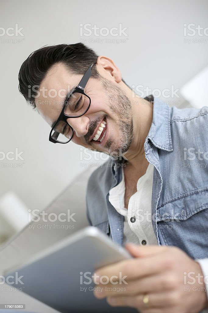 Good news from digital tablet for this man royalty-free stock photo