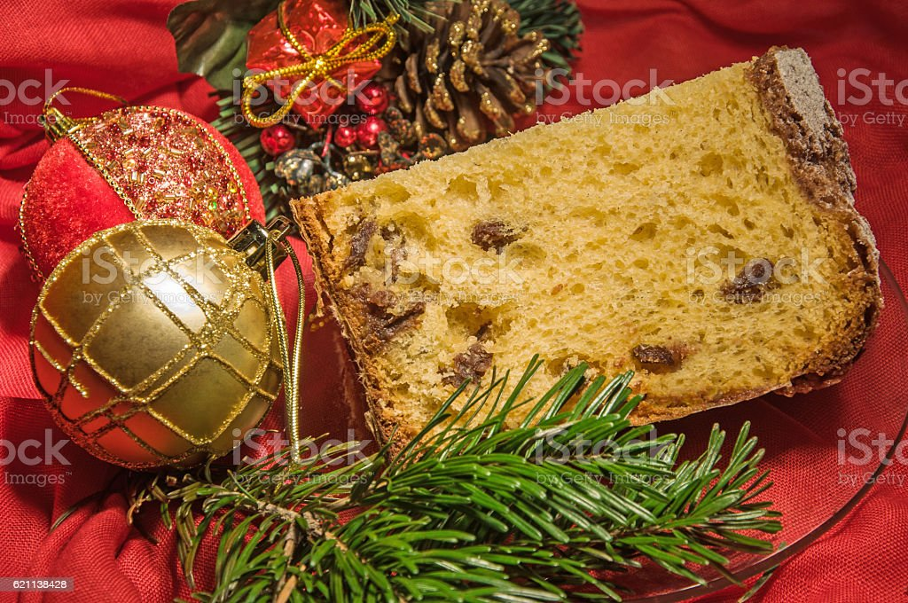 Good piece of homemade panettone on holiday background. Christmas theme. stock photo