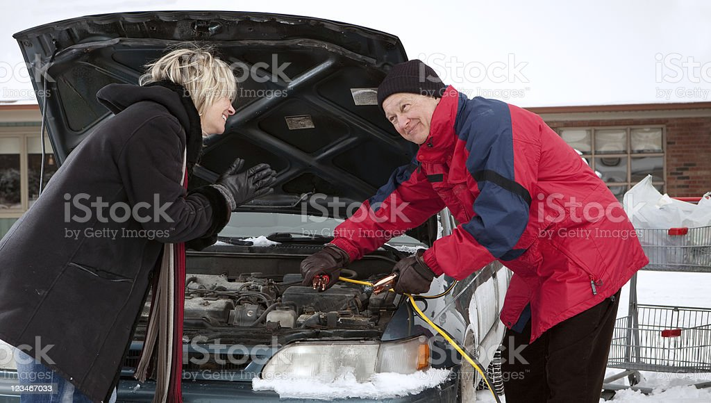 Good samaritan giving a boost stock photo