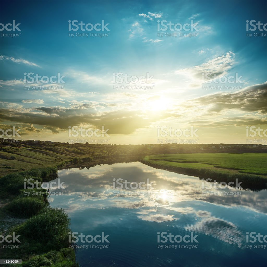 good sunset over river with reflections stock photo