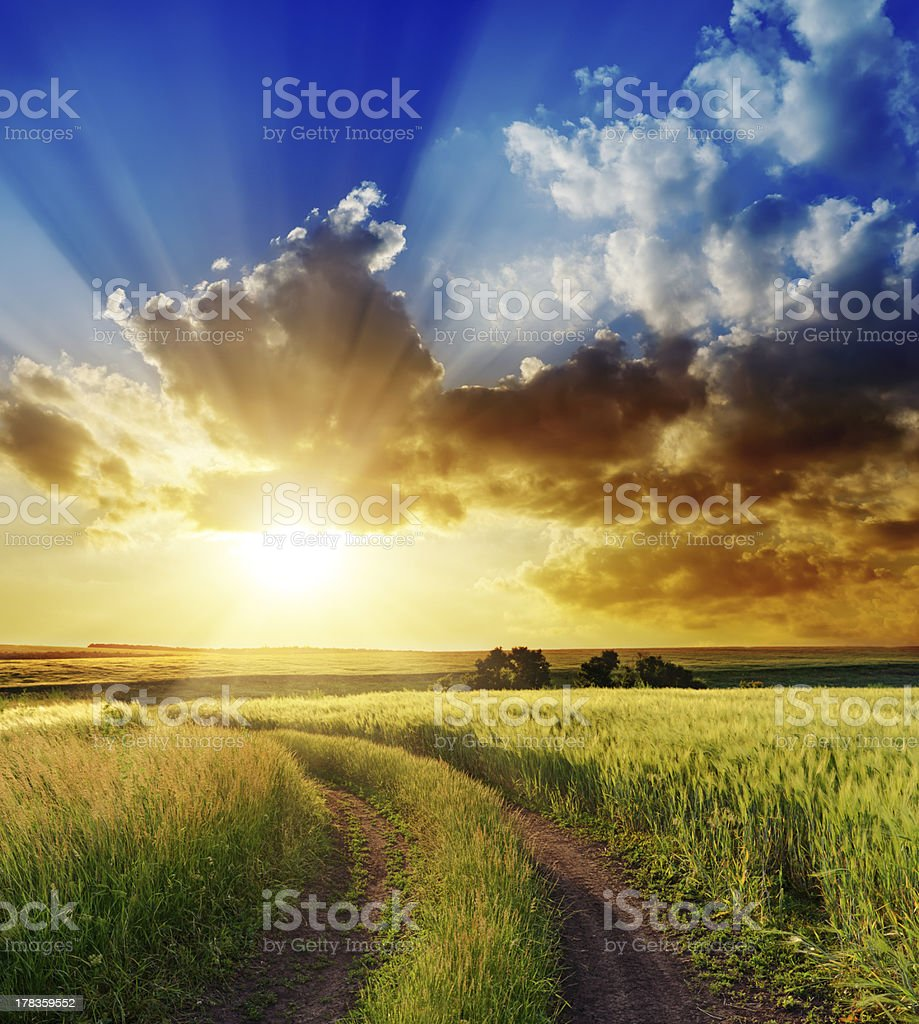 good sunset over rural road royalty-free stock photo