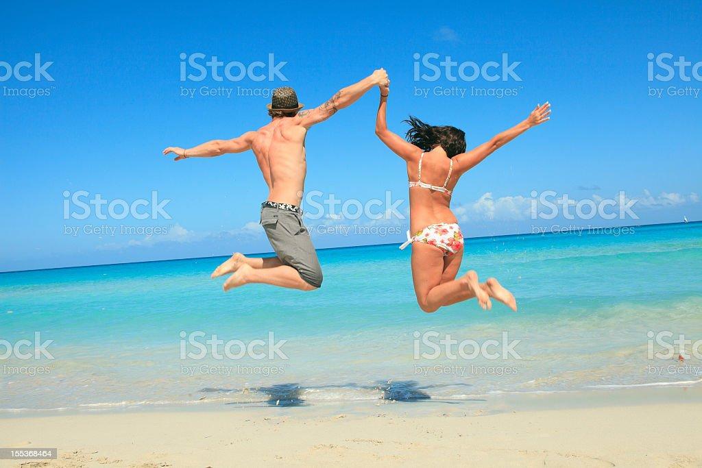 Good Time Beach - Couple Jump royalty-free stock photo