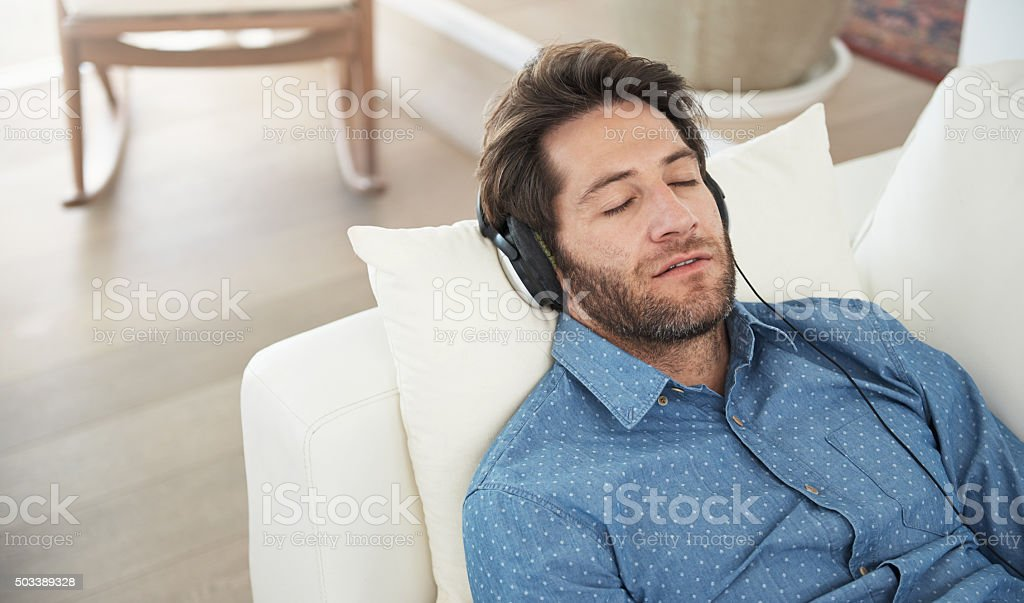 Good tunes put him to sleep stock photo