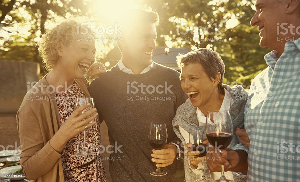Good wine makes for fun family celebrations stock photo