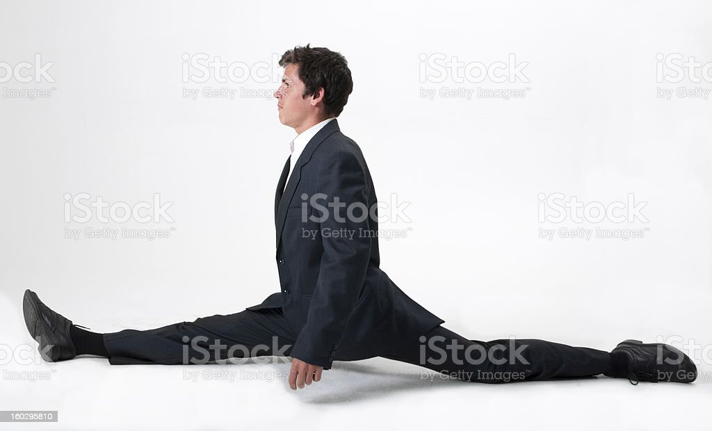 Good-looking businessman doing splits stock photo