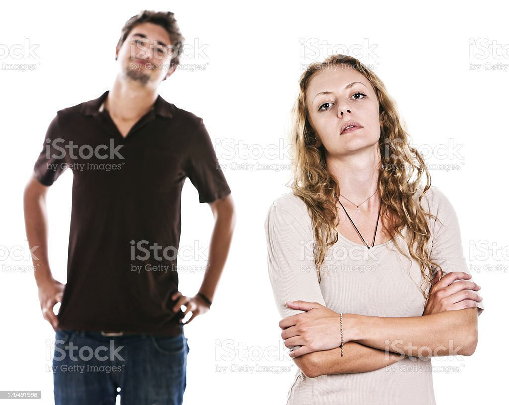 Good-looking couple: she is serious, he smiles stock photo