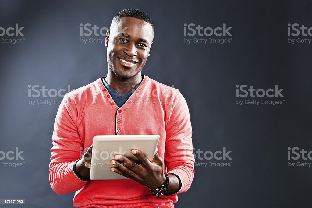 Good-looking man with digital tablet smiles happily. stock photo