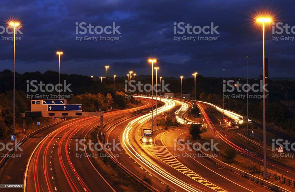 Goods Vehicle Breakdown at Dusk on Motorway with Light Trails royalty-free stock photo