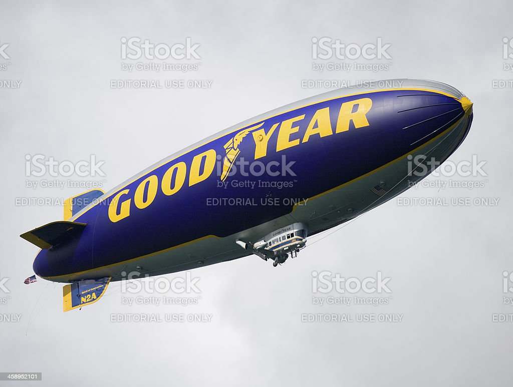 Goodyear blimp flying in the clouds stock photo