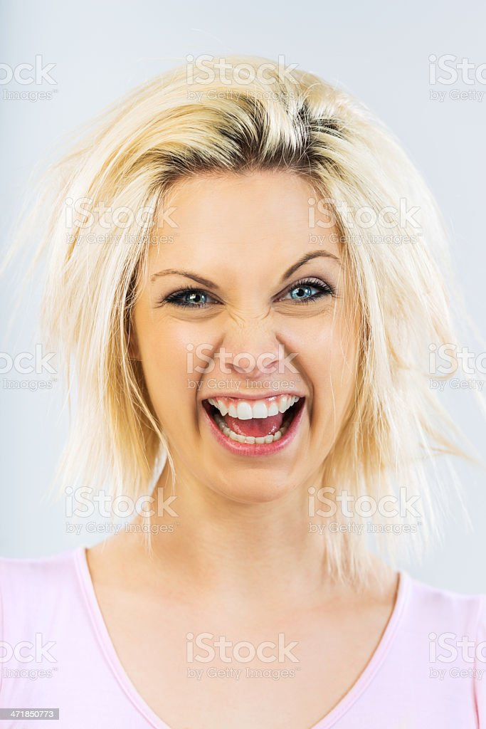 Goofing young woman. royalty-free stock photo