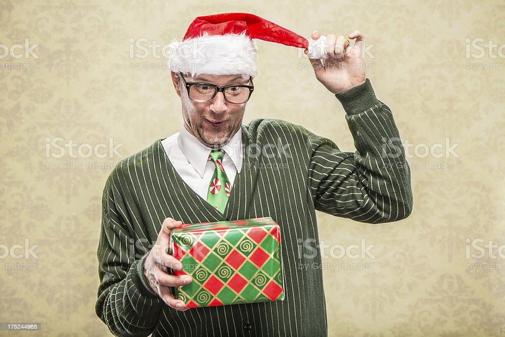 Goofy Dad with Christmas Present at Family Holiday Exchange royalty-free stock photo