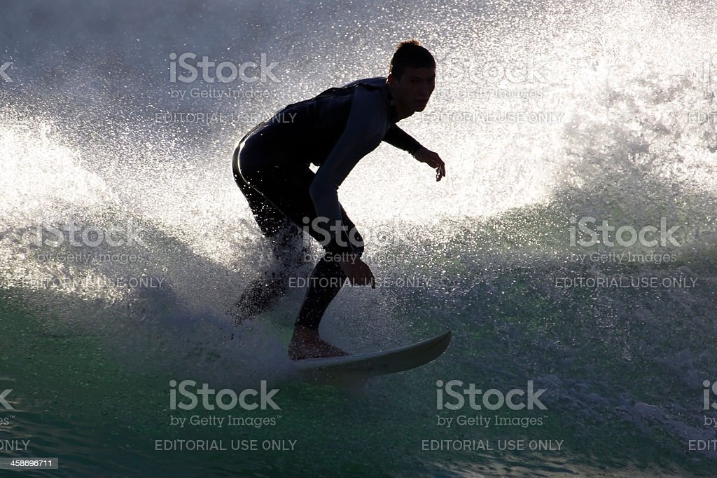 Goofy Footed Surfer Riding a Wave stock photo