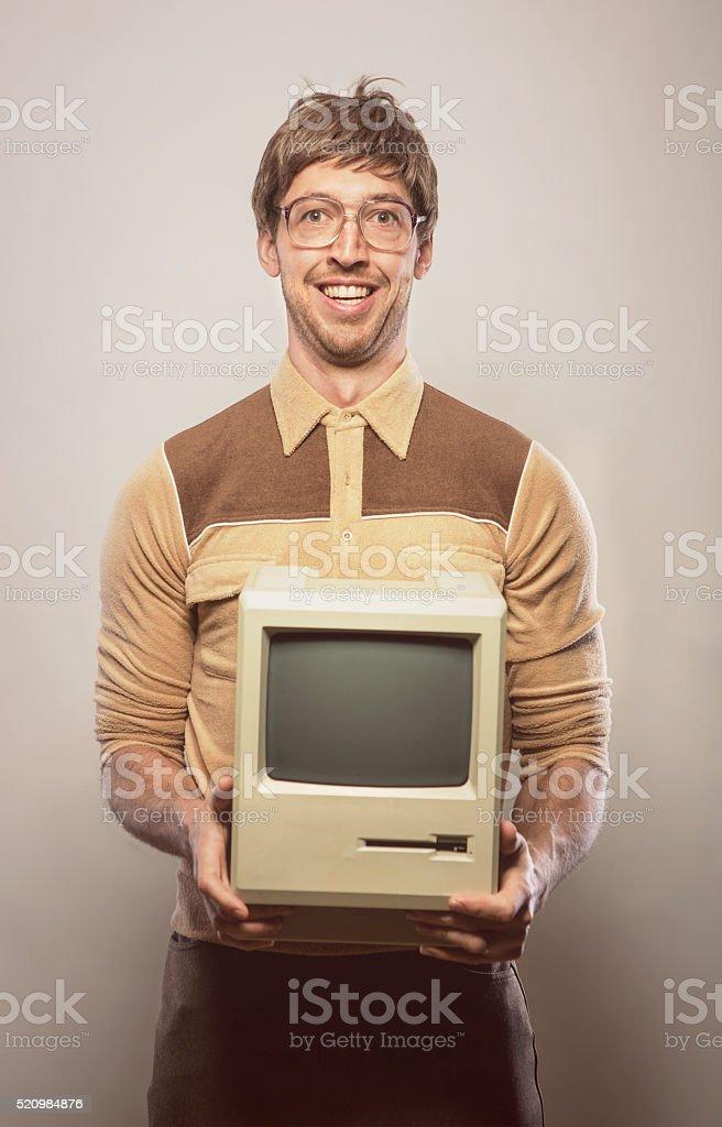 Goofy glasses wearing nerdy IT Computer guy stock photo