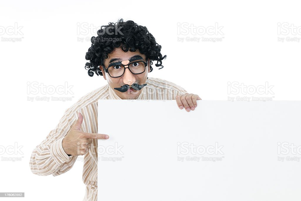 Goofy guy holding a signboard royalty-free stock photo