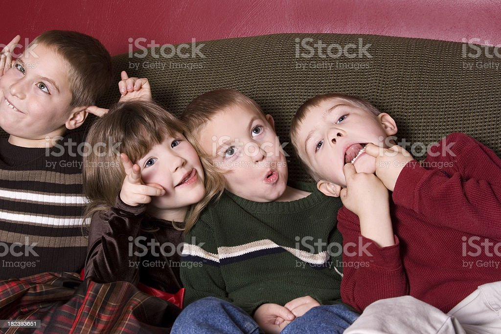 Goofy Kids on the couch stock photo