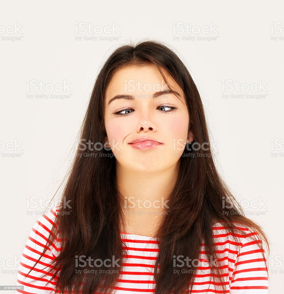 Goofy young girl making a grimace. stock photo