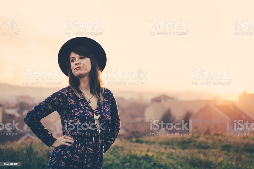 Goofy-faced hipster girl in a majestic viewport stock photo