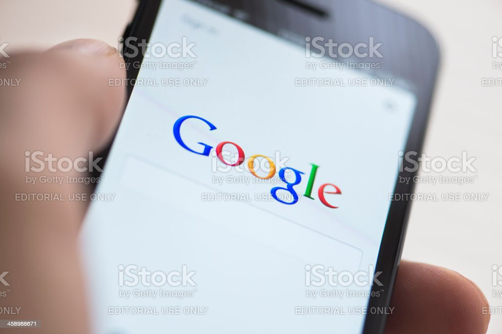 Google app on Apple iPhone 5 stock photo