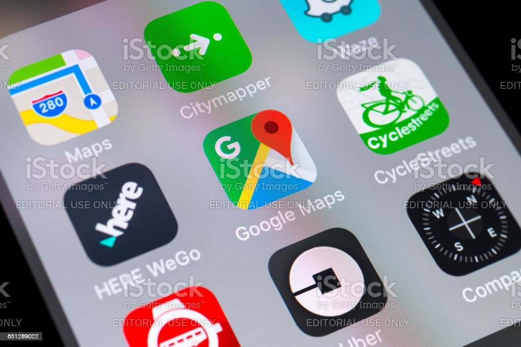 Google Maps, HERE WeGo, CycleStreets and other travel apps on cellphone stock photo