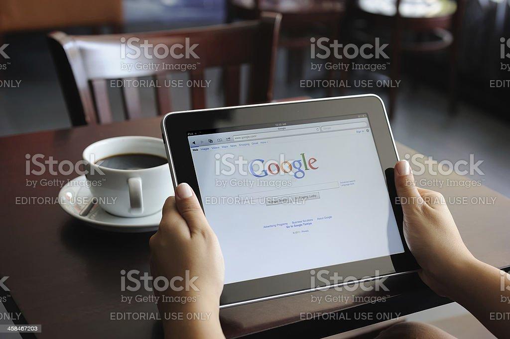 Google on iPad stock photo