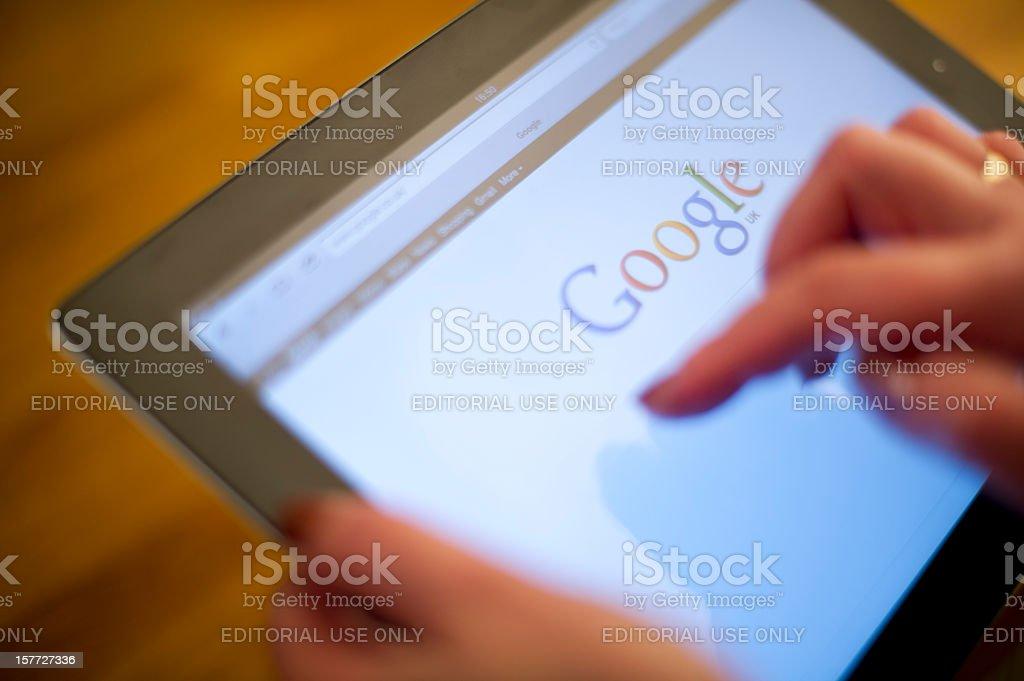 Google on iPad2 screen stock photo