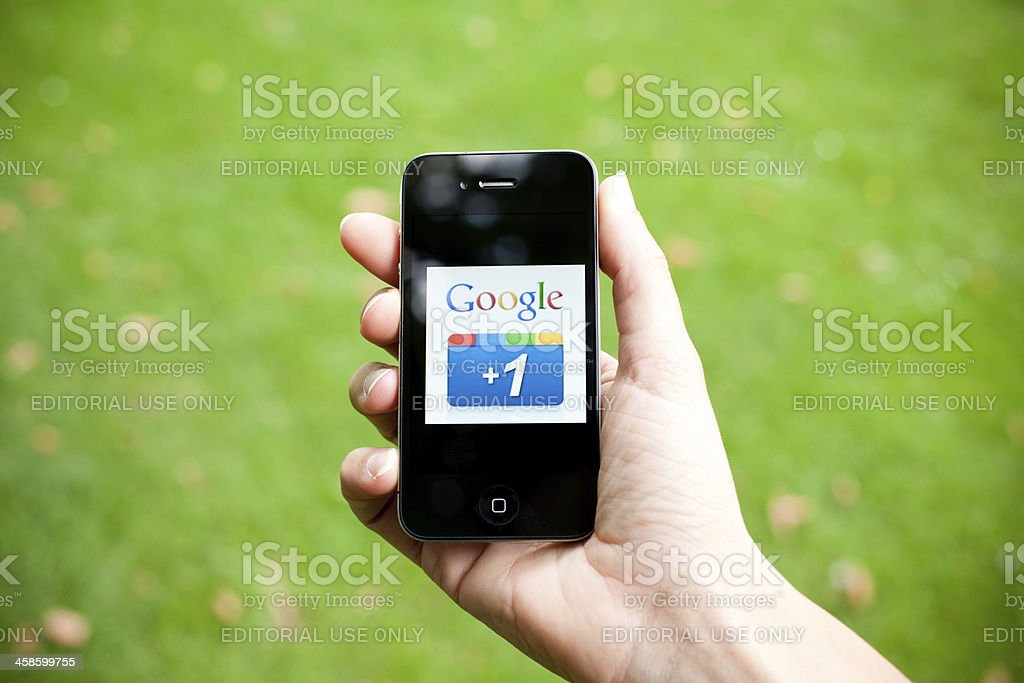 Google Plus Like Button on Iphone 4, Outdoors royalty-free stock photo