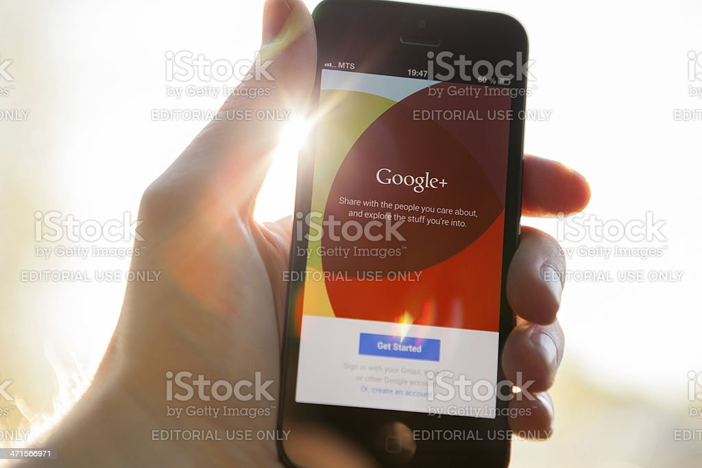Google Plus on iPhone 5 stock photo