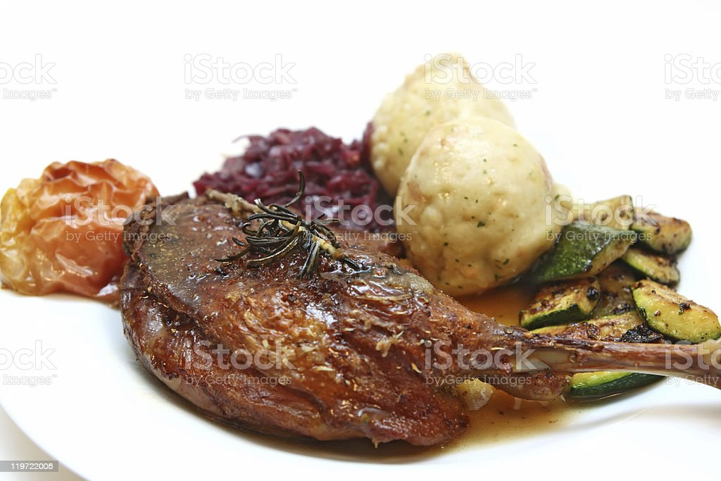 Goose drumsticks with dumplings and red cabbage stock photo