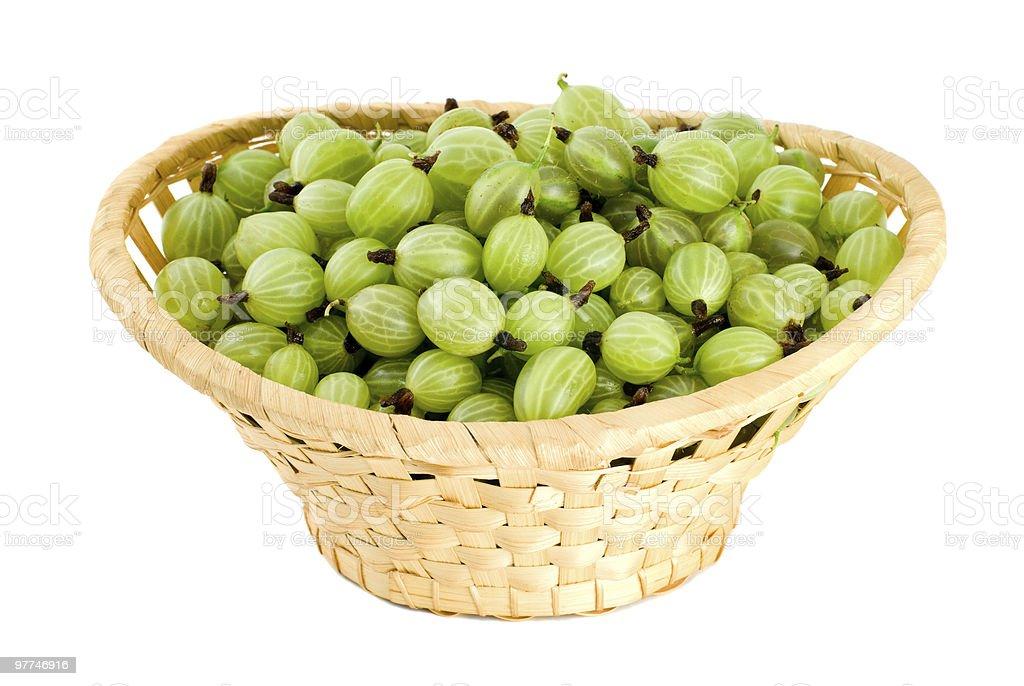 Gooseberries in the wicker basket royalty-free stock photo