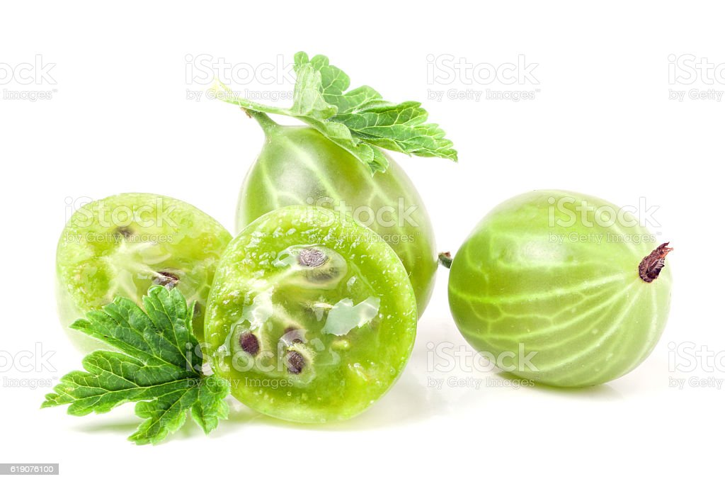 gooseberries with leaf and half isolated on white background stock photo