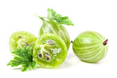 gooseberries with leaf and half isolated on white background