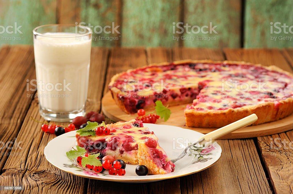 Gooseberry pie slice, glass of milk and pie stock photo