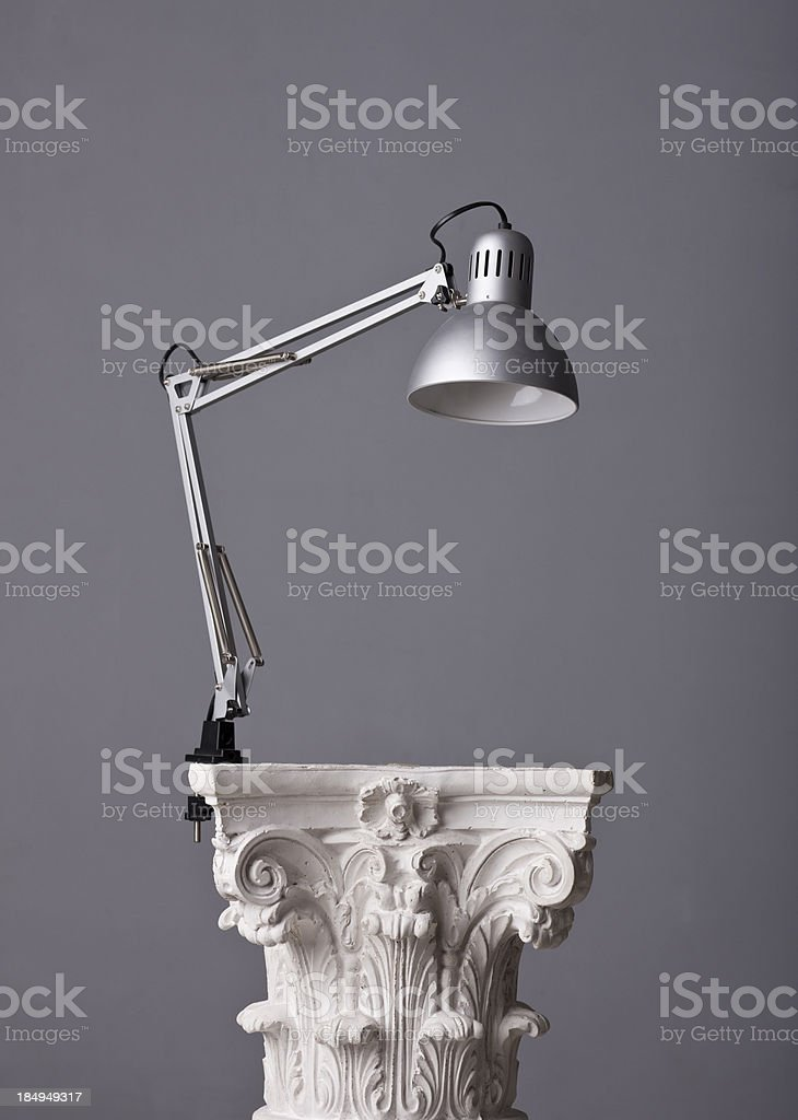 gooseneck office lamp on a corinthian capital stock photo