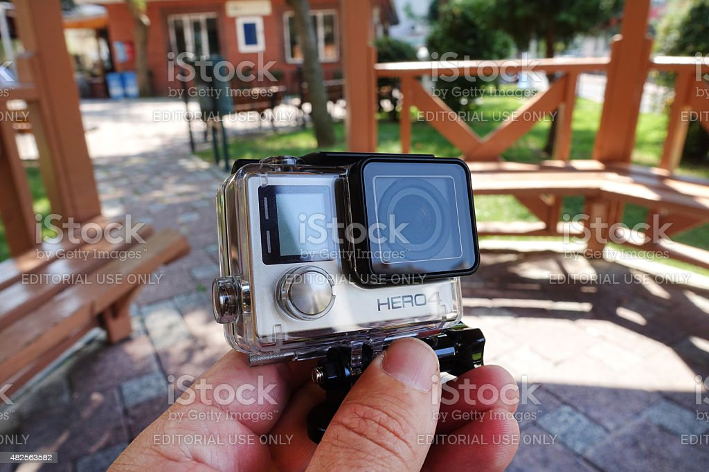 GoPro Hero 4 Black Edition  in hand stock photo