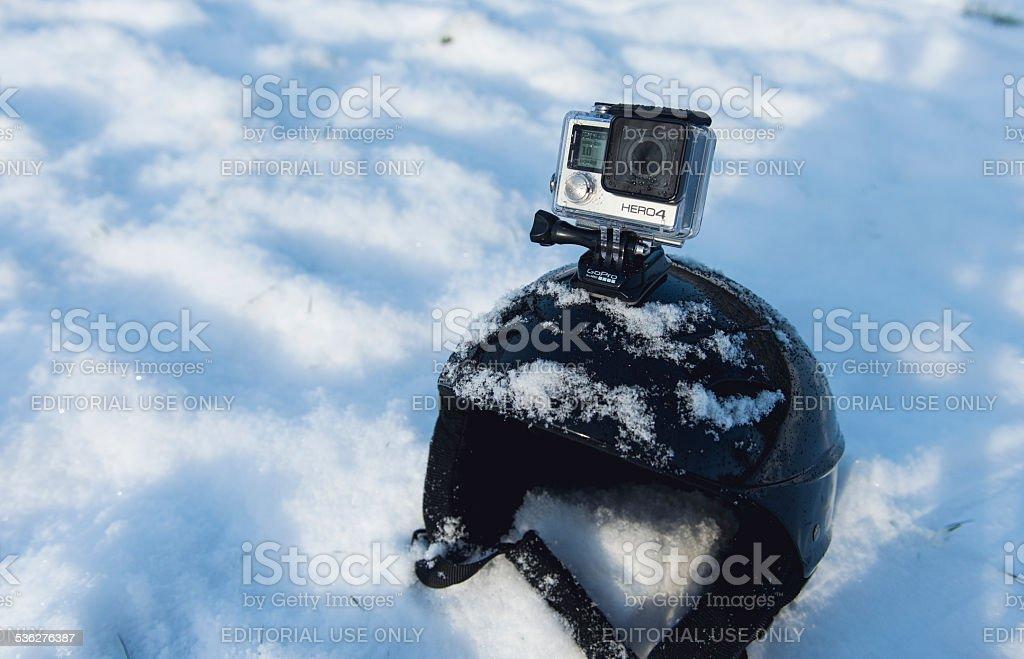 GoPro Hero 4 Black Edition mounted on skiing helmet stock photo
