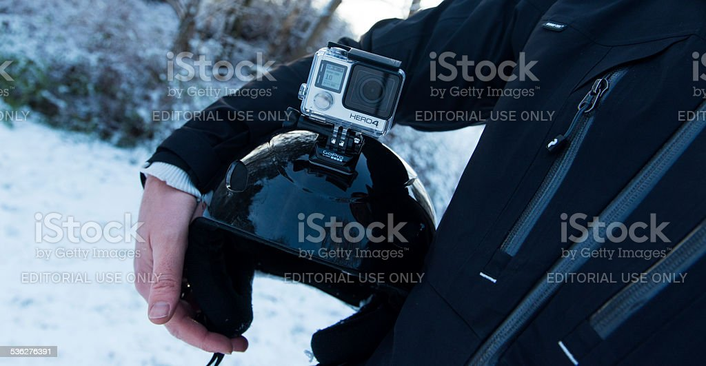 GoPro Hero 4 Black Edition mounted on skiing helmet stock photo
